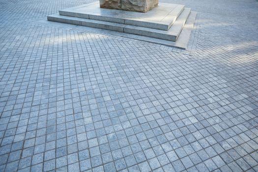 Grey pavement near column