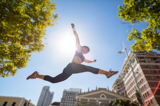 Athletic woman leaping