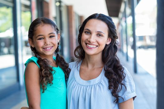 Portrait of a mother and her daughter smiling