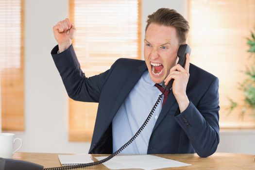 Furious businessman outraged on the phone