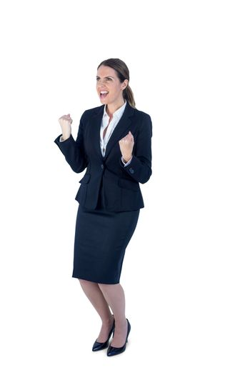A businesswoman cheering and yelling