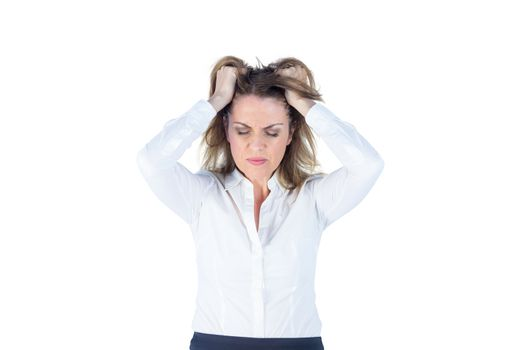 Stressed businesswoman with hands on her head