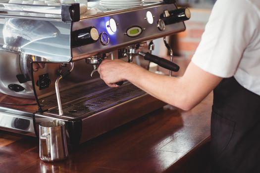 Barista preparing coffee machine