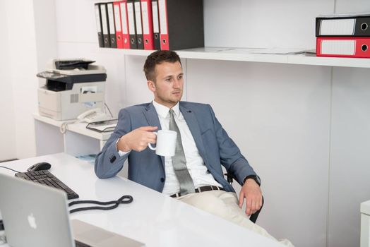Young Business Man With Problems And Stress In The Office