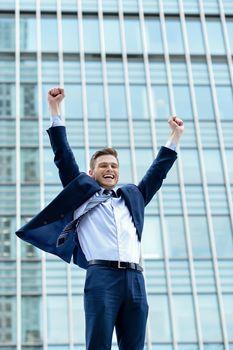 Portrait of a young businessman celebrating his success