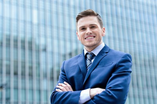 Businessman standing at outdoors.