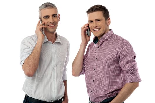 Casual smiling men communicate via cell phone