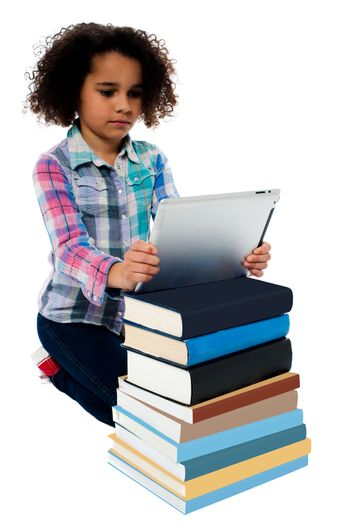 Cute girl with stack of books and tablet pc