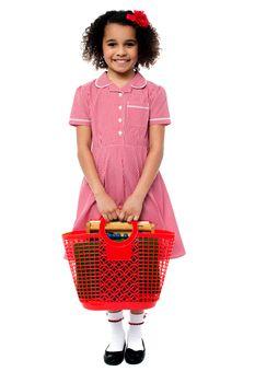 Smiling school girl carrying a basket bag