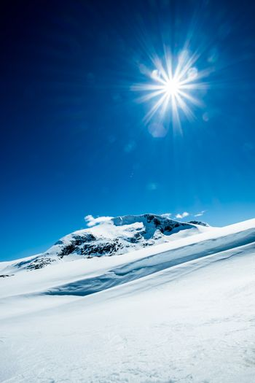 Sun and snowy mountain.