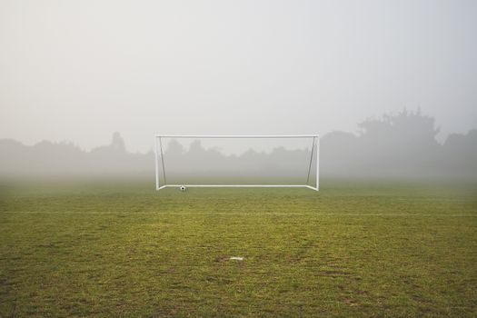 football pitch on a foggy winters day