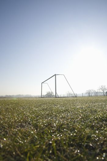 empty football pitch and goal on a frosty winter morning sunrise