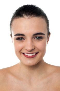 Closeup image of teen girl posing topless