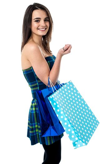 Trendy girl with polka dots shopping bags