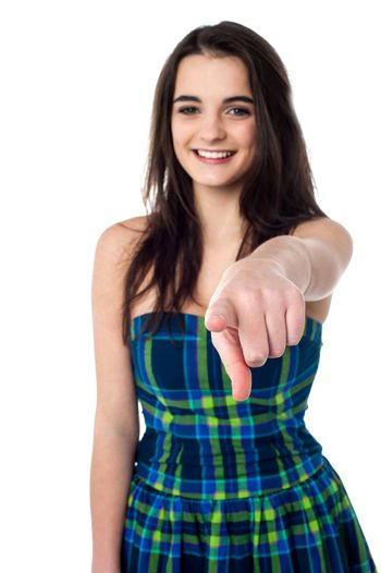 Stylish teen girl pointing her finger to camera
