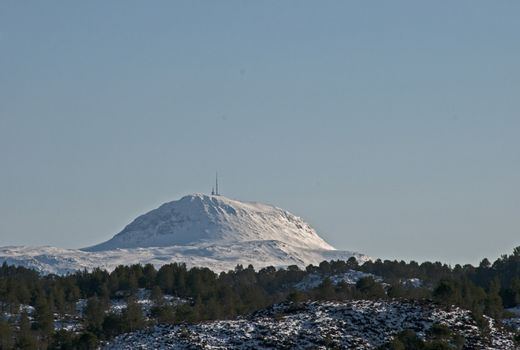 The mountain Rensfjellet with tv-tower