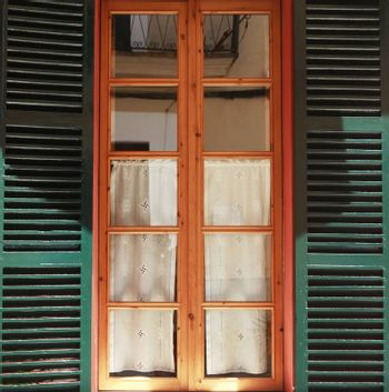 Wooden green window. Old town Alcudia