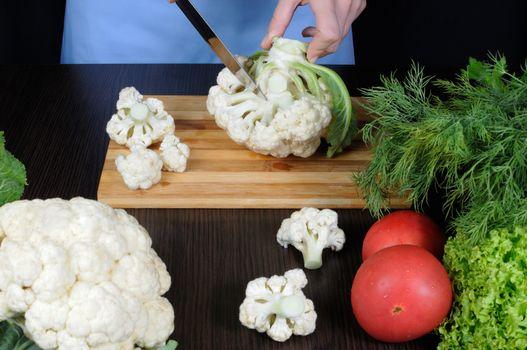 cauliflower on a cutting board