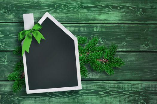 House shaped chalkboard on Christmas background