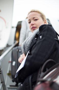 Woman boarding airplain.