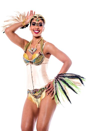 Image of a woman samba dancer posing over white
