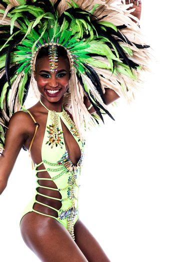 Side pose of cheerful carnival dancer woman