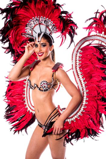 Beautiful carnival dancer in amazing costume over white