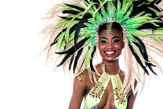 Cheerful samba dancer posing to camera over white