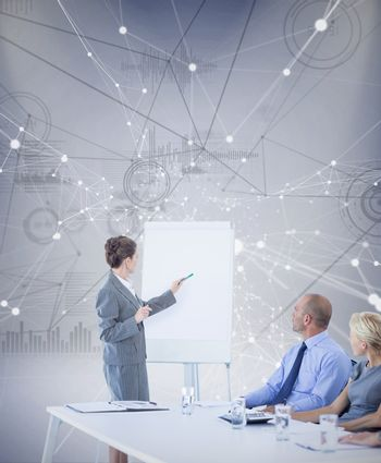 Composite image of business people looking at meeting board during conference