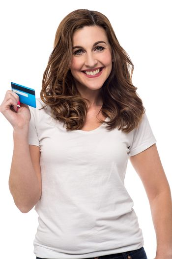 Smiling woman showing her credit card