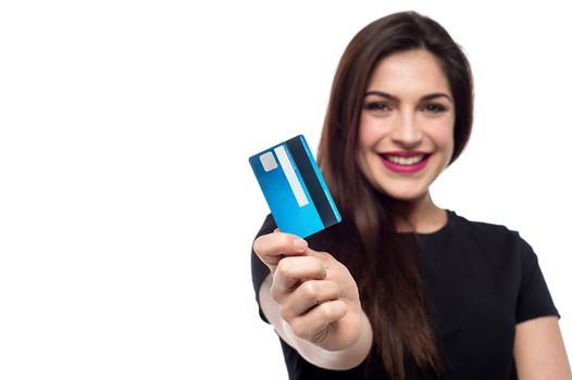 Cheerful woman showing her credit card to camera
