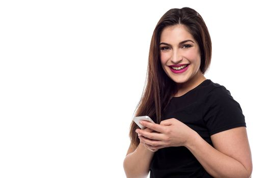 Smiling woman posing with new mobile phone