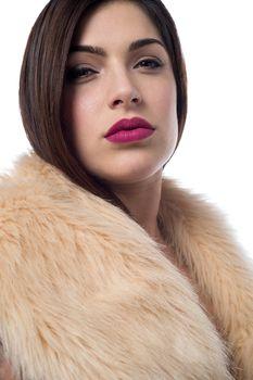 Pretty trendy woman in luxurious fur coat