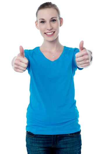 Woman making thumb up gesture by two hands
