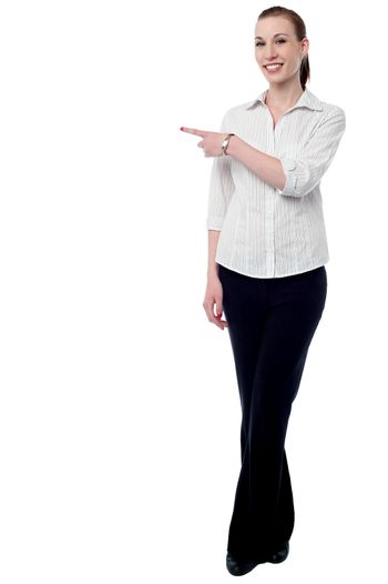 Young business woman pointing something