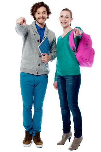 Cheerful classmates pointing finger to camera
