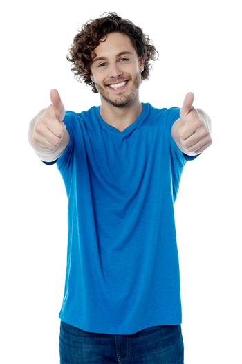 Happy young man showing thumbs up gesture