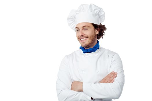 Confident male chef looking at copy space