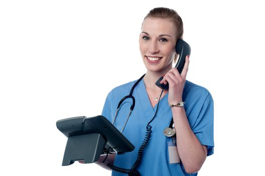 Happy female physician attending a phone call