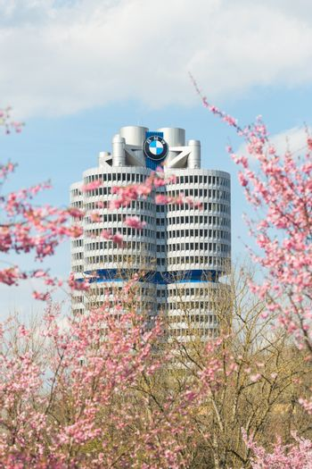 BMW headquarters tower office building in spring blossoming Olym