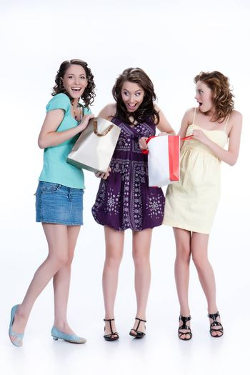 Young woman with shopping bag in different actions and emotions