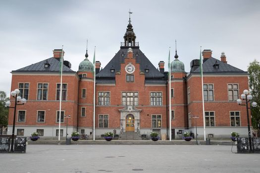 The Town House in Umea, Sweden with clouds in the background.