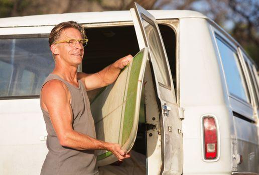 Man Removing Surfboard