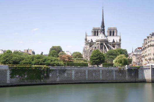 The Notre Dame Cathedral in Paris, France with its river Seine in front of it.