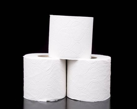Three Rolls of Toilet Paper with black background.