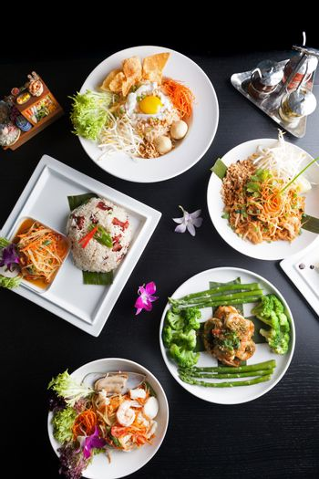 Top down view of a variety of authentic Thai and stir fry dishes.  Shallow depth of field.