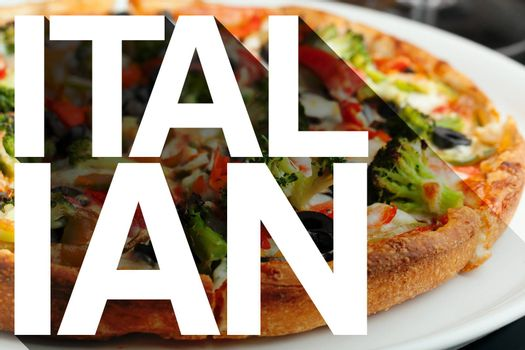 The word Italian with long shadow effect in front of a pizza with a variety of toppings.