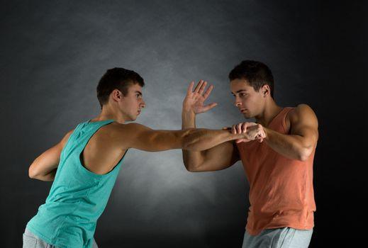 young men wrestling