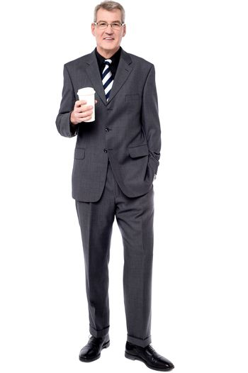 Business man with paper cup over white background