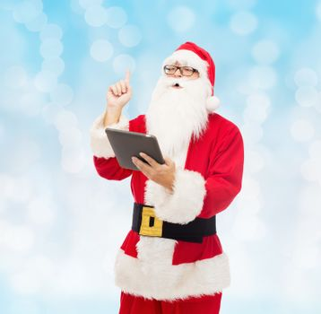 christmas, holidays, technology and people concept - man in costume of santa claus with tablet pc computer pointing finger up over blue lights background
